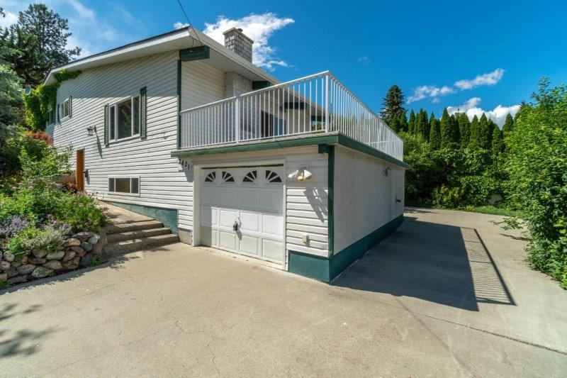 Best Parking in Town! Stunning 4 Level Split Family Home on a Large Fenced Corner Lot!  5 Bedrooms & 3 Baths